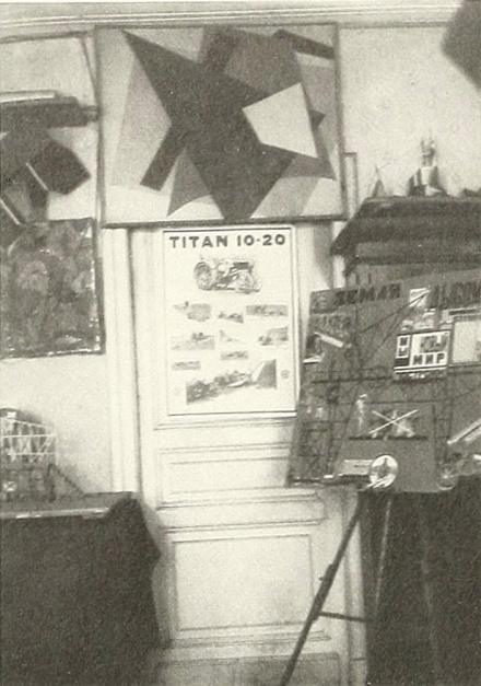 Popova's Moscow studio, 1924 photographed by Alexander Rodchenko showing her maquette for The Magnanimous Cuckold (1922) Painterly Architectonics (1917)