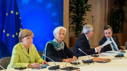 Germany and the Troika: (left to right) German Chancellor Angela Merkel, IMF Managing Director Christine Lagarde, European Commission President Jean-Claude Juncker, European Central Bank President Mario Draghi